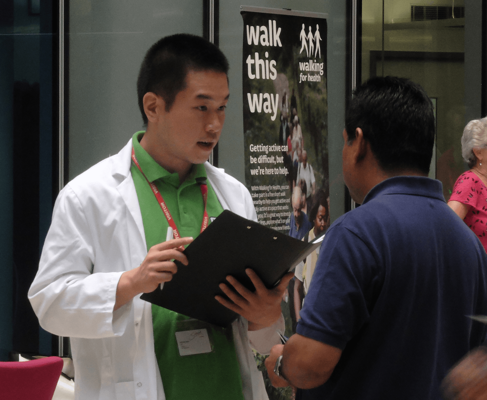 Walk doctor talking with clipboard