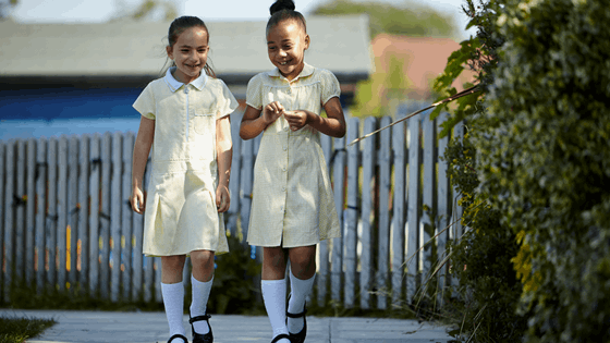 Two girls walking to school