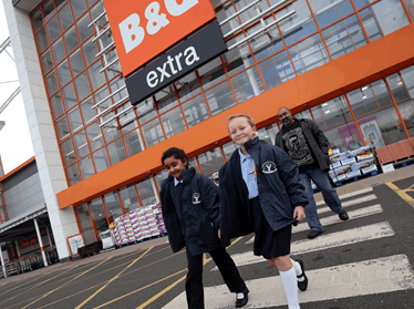 Children walking across B and Q car park for park and stride scheme
