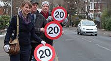 Road safety protesters with 20 mph signs