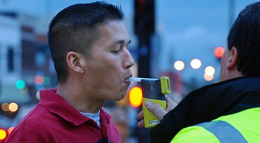 man being breathalyzed