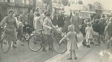 archive picture of children and cyclists blocking a road in protest of road safety