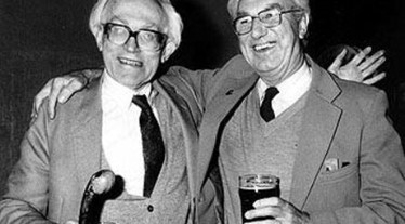 Portrait of Michael Foot and RonLemin arm in arm