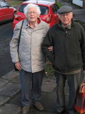 portrait of Margaret and Bob walking to the shops