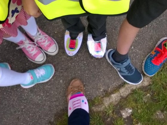 Photo of children wearing their happy shoes