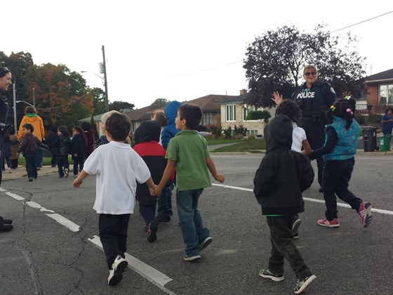 Photo of children in Canada crossing the road on the way to school