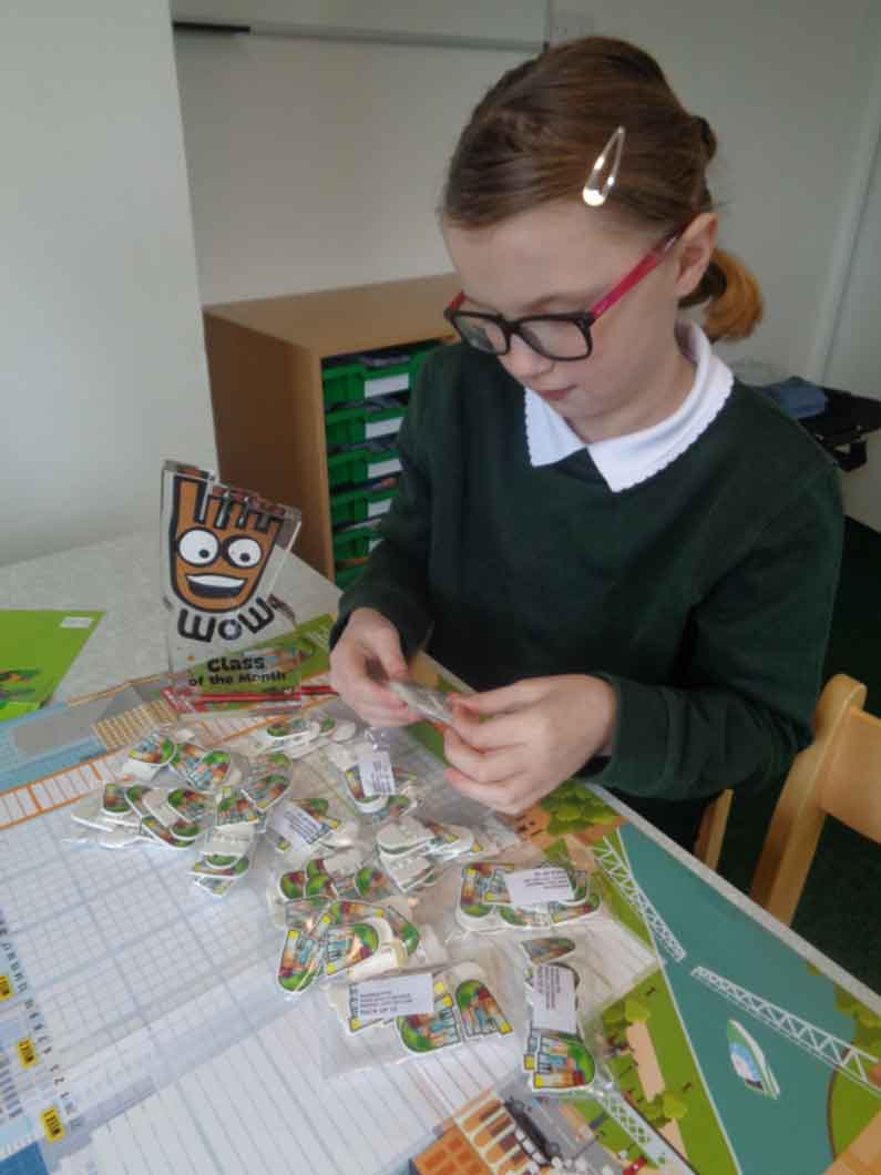 Percy Main Primary pupil sorts WOW badges
