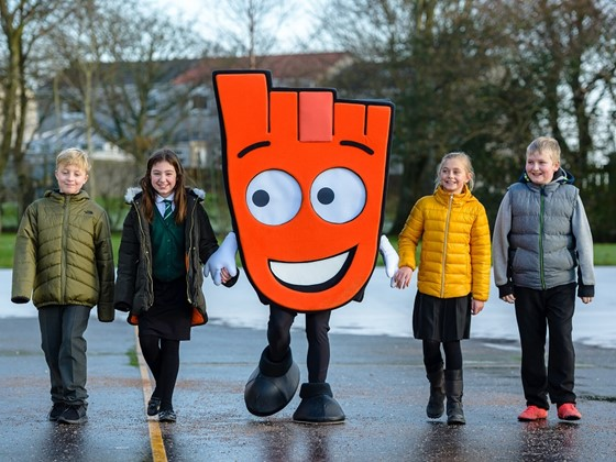 Pupils are joined by Strider for their walk to school