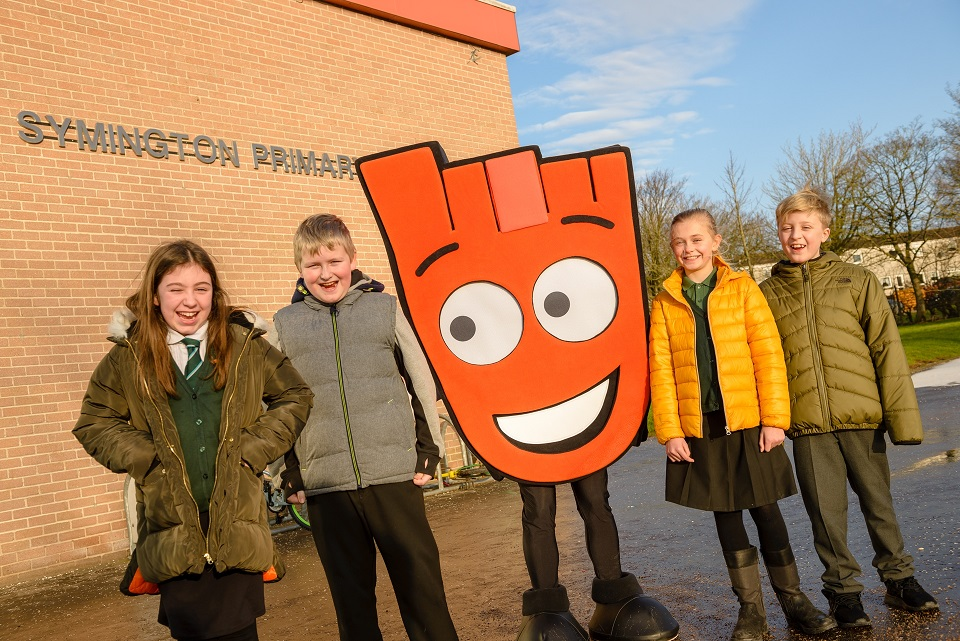 Pupils from Symington Primary School stood outside with Strider mascot